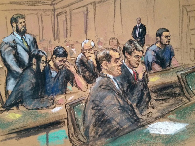 Attorney Eridania Perez sits beside Efrain Antonio Campo Flores as Attorney John J Reilly talks with him, in federal court in Manhattan, New York