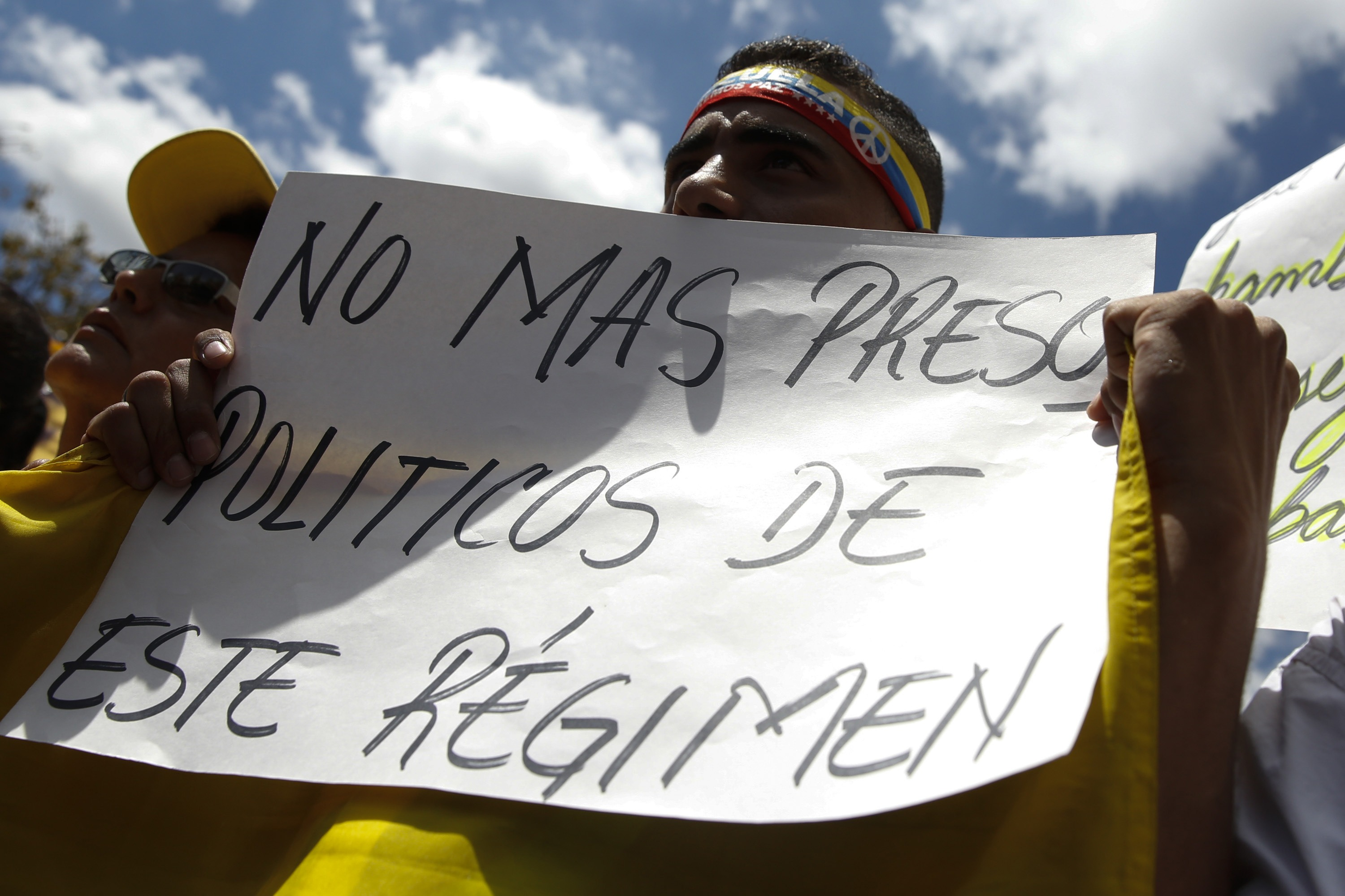 A supporter of Ledezma holds a banner during a gathering in support of him in Caracas