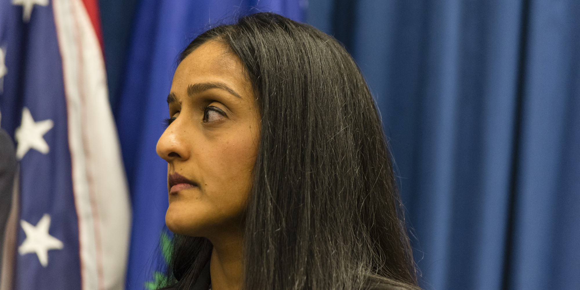 CLEVELAND, OH- DECEMBER 4: U.S. Acting Assistant Attorney General EVanita Gupta listens as U.S. Attorney Steve Dettlebach speaks to reporters at a press conference on December 4, 2014 oin Cleveland, Ohio. U.S. Attorney General Eric Holder, Acting Assistant Attorney General Vanita Gupta, and U.S. Attorney Steven Dettelbach spoke at the press conference before hosting a community roundtable discussion as part of the Justice Department's 'Building Community Trust' initiative.  (Photo by Angelo Merendino/Getty Images)