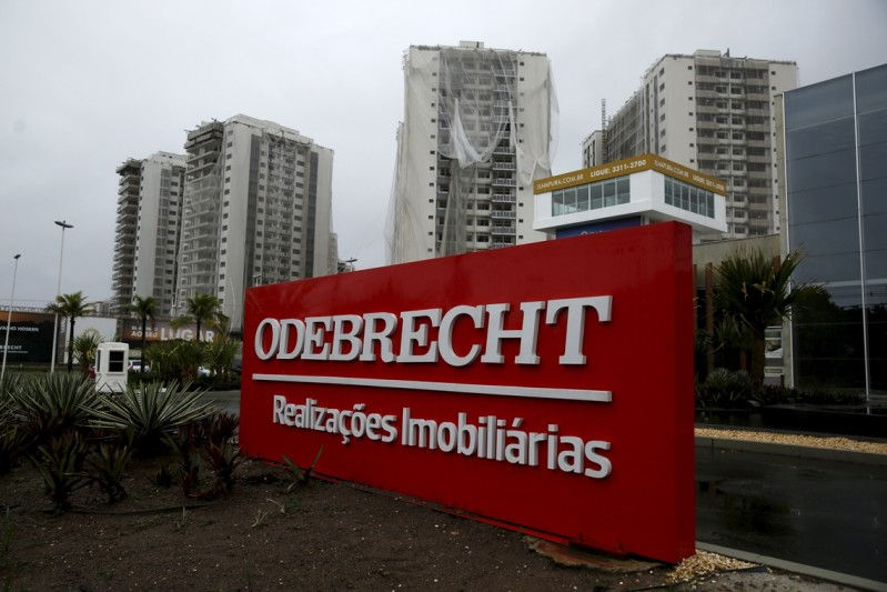 An Odebrecht placard is pictured in front of a construction site in Rio de Janeiro