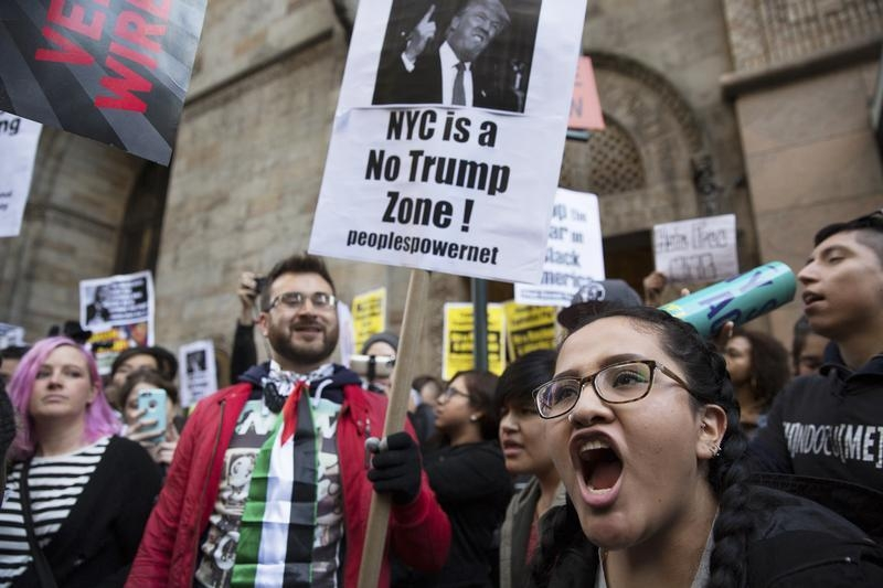 Protesters demonstrate against Republican U.S. presidential candidate Donald Trump in midtown Manhattan in New York City April 14, 2016.   REUTERS/Elizabeth Shafiroff - RTX2A16W