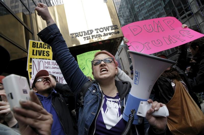 Demonstrators protest against U.S. Republican presidential candidate Donald Trump, outside the Trump Tower building in midtown Manhattan in New York March 19, 2016. REUTERS/Brendan McDermid