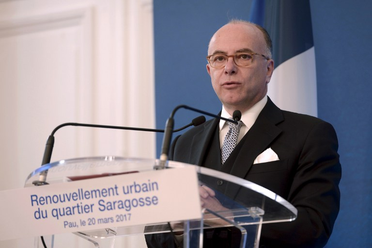 French Prime Minister Bernard Cazeneuve speaks during a visit focused on the Saragosse district renovation plan on March 20, 2017 in Pau, southern France. / AFP PHOTO / IROZ GAIZKA