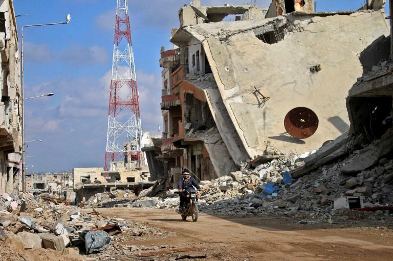 AFP PHOTO / MOHAMAD ABAZEED
