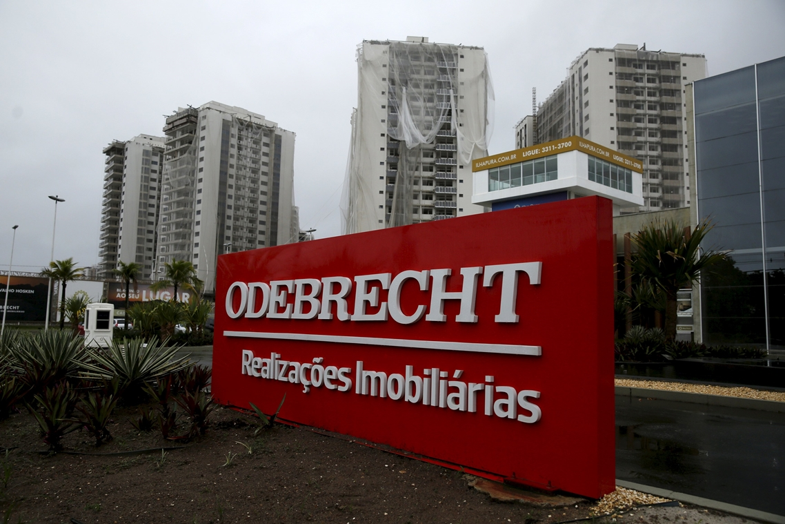 An Odebrecht placard is pictured in front of a construction site in Rio de Janeiro, Brazil, June 19, 2015. Federal police agent Igor Romario confirmed that Odebrecht CEO Marcelo Odebrecht and Andrade Gutierrez CEO Otavio Marques Azevedo were among 12 people arrested on Friday in a corruption investigation at state-run oil firm Petrobras. Brazilian prosecutor Carlos Fernando dos Santos Lima said at a news conference in the southern city of Curitiba that an investigation into Brazil's two largest construction firms uncovered a sophisticated scheme of illegal acts, including participating in a cartel and fraud in project bidding. REUTERS/Pilar Olivares
