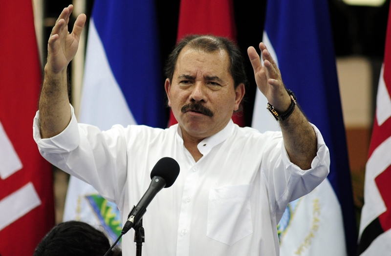 Nicaragua's President Daniel Ortega addresses the audience in Managua October 6, 2011. Ortega handed over 110 buses, purchased in Mexico and with a loan from the American Bank of Economic integration, to the public transportation unions, according to local media.  REUTERS/Jorge Cabrera (NICARAGUA - Tags: POLITICS)