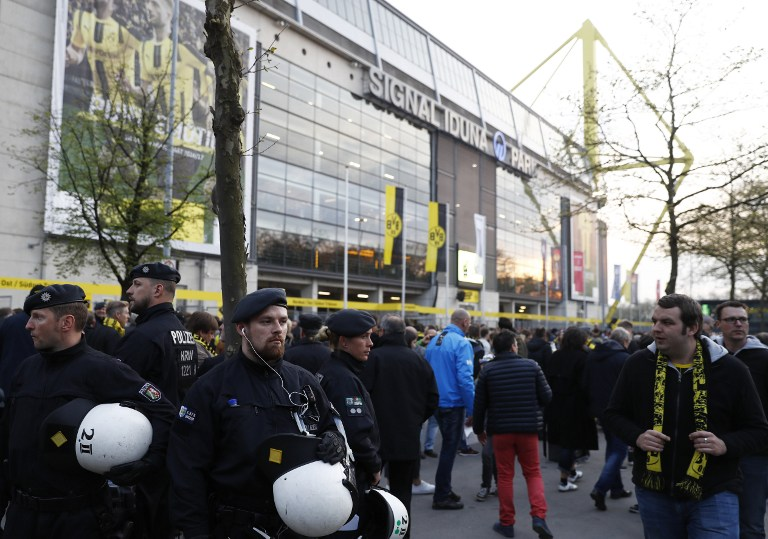 Police patrol outide the stadium after the team bus of Borussia Dortmund had some windows broken by an explosion some 10km away from the stadium prior to the UEFA Champions League 1st leg quarter-final football match BVB Borussia Dortmund v Monaco in Dortmund, western Germany on April 11, 2017. / AFP PHOTO / Odd ANDERSEN