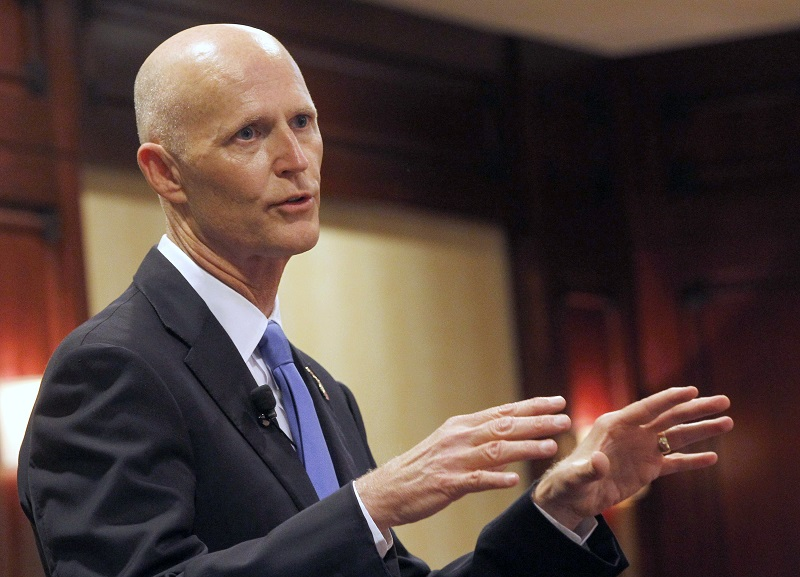 Republican Florida Gov. Rick Scott speaks during during the Valley Industry and Commerce Association (VICA) Leaders Forum in the Woodland Hills area of Los Angeles on Monday, April 13, 2015. Scott is the latest in a string of out-of-state governors to try to raid businesses and jobs from California, home to nearly 40 million people and by itself one of the world's largest economies. (AP Photo/Nick Ut)