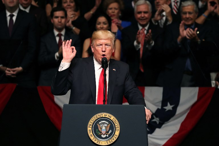 MIAMI, FL - JUNE 16: U.S. President Donald Trump speaks about policy changes he is making toward Cuba at the Manuel Artime Theater in the Little Havana neighborhood on June 16, 2017 in Miami, Florida. The President will re-institute some of the restrictions on travel to Cuba and U.S. business dealings with entities tied to the Cuban military and intelligence services.   Joe Raedle/Getty Images/AFP