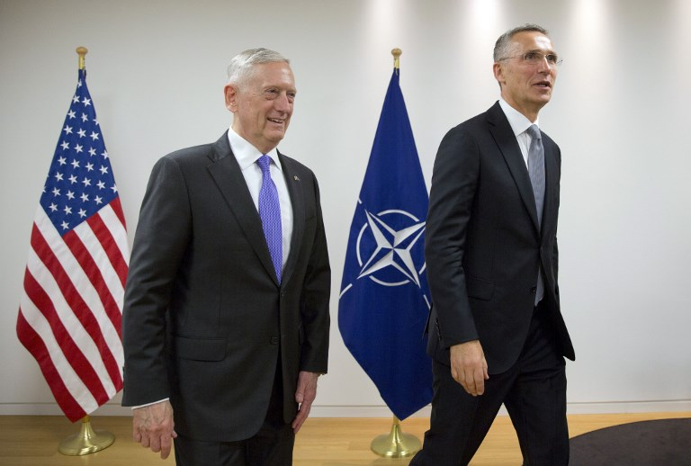 U.S. Secretary for Defense Jim Mattis (L) walks with NATO Secretary General Jens Stoltenberg prior to a meeting at NATO headquarters in Brussels on June 29, 2017. NATO defense ministers meet to discuss, among other issues, the situation in Afghanistan and defense spending.  / AFP PHOTO / POOL / Virginia Mayo