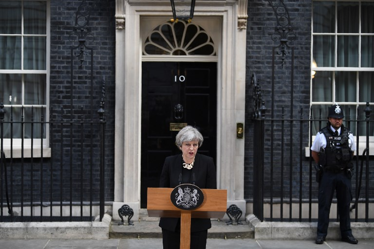 Britain's Prime Minister Theresa May delivers a statement outside 10 Downing Street in central London on June 4, 2017, following the June 3 terror attack. Forty-eight people have been taken to hospital after a terror attack in central London in which seven people died, the London Ambulance Service said Sunday. / AFP PHOTO / Justin TALLIS