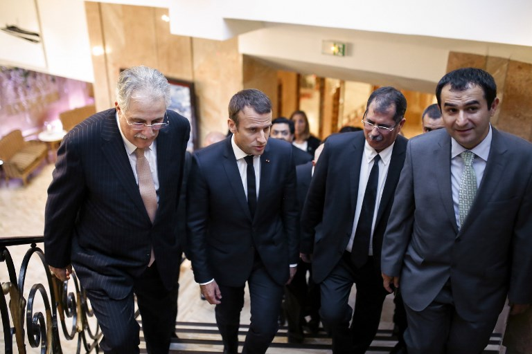 (LtoR) Vice-President of the French Council of the Muslim Faith (CFCM) Chems-Eddine Hafiz, French President Emmanuel Macron, CFCM President Anouar Kbibech and CFM Vice-President Ahmet Ogras, arrive to attend a dinner organised by the French Council of the Muslim Faith (CFCM) to break the fast of Ramadan, in Paris, on June 20, 2017. / AFP PHOTO / Benjamin CREMEL