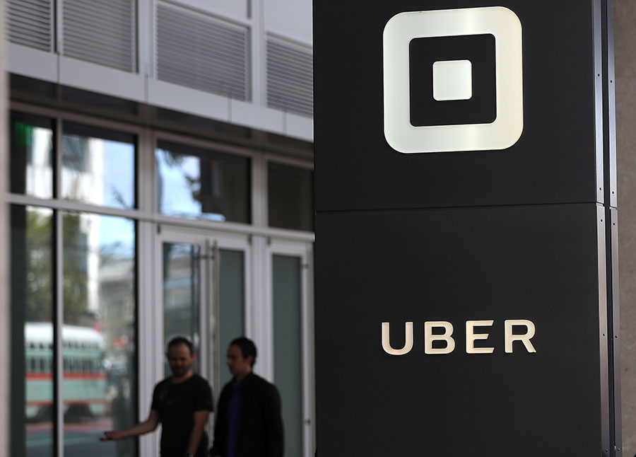 "(FILES) This file photo taken on August 25, 2016 shows the logo of the ride sharing service Uber  in front of its headquarters in San Francisco, California.  Uber has parted ways with another top executive, in the latest dent to the reputation of the ridesharing giant as it prepares to release the results of a probe into workplace misconduct. The executive, Eric Alexander, read and discussed medical information about a woman raped in India in 2014 during an Uber ride, according to reports in the New York Times and Recode.An Uber spokeswoman told AFP on June 8, 2017 that Alexander is ""no longer with the company,"" but declined to comment on the reasons for his departure or on the reports on his handling of the India rape case.  / AFP PHOTO / GETTY IMAGES NORTH AMERICA / JUSTIN SULLIVAN"