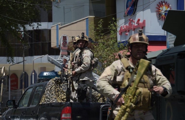"Afghan security personnel arrive at the site of a suicide blast near Iraq's embassy in Kabul on July 31, 2017.  A series of explosions and the sound of gunfire shook the Afghan capital on July 31, with a security source telling AFP that a suicide bomber had blown himself up in front of the Iraqi embassy. ""Civilians are being evacuated"" from the area as the attack is ongoing, said the official, who declined to be named.   / AFP PHOTO / SHAH MARAI"