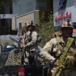 """Afghan security personnel arrive at the site of a suicide blast near Iraq's embassy in Kabul on July 31, 2017.  A series of explosions and the sound of gunfire shook the Afghan capital on July 31, with a security source telling AFP that a suicide bomber had blown himself up in front of the Iraqi embassy. """"Civilians are being evacuated"""" from the area as the attack is ongoing, said the official, who declined to be named.   / AFP PHOTO / SHAH MARAI"""