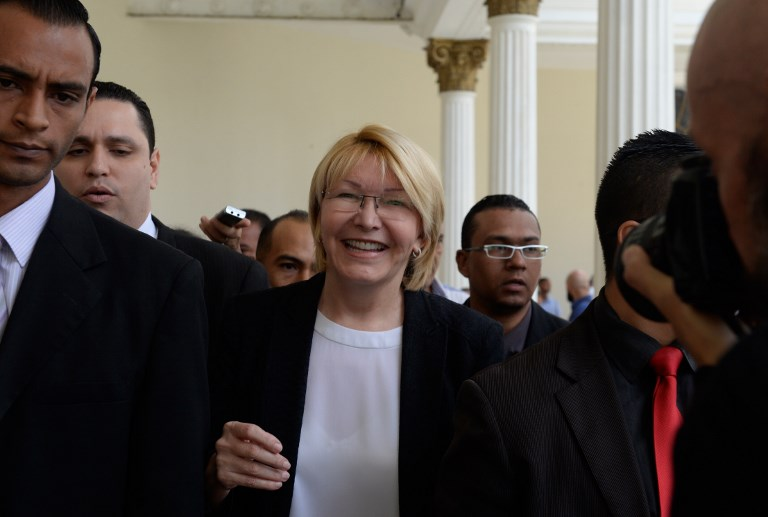 Attorney General Luisa Ortega, the most high-profile official to break ranks with Venezuelan President Nicolas Maduro, smiles at the National Assembly in Caracas, on July 3, 2017. A political and economic crisis in the oil-producing country has spawned often violent demonstrations by protesters demanding Maduro's resignation and new elections. The unrest has left 89 people dead since April 1. / AFP PHOTO / Federico PARRA