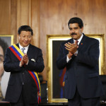 China's President Xi claps with his Venezuelan counterpart Maduro, at their meeting at Miraflores Palace in Caracas