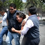 People react as a real quake rattles Mexico City on September 19, 2017 moments after an earthquake drill was held in the capital. A 7.1 magnitude earthquake shook Mexico City on Tuesday, destroying buildings and causing an unknown number of casualties on the anniversary of a devastating 1985 quake. The quake sowed panic in the sprawling city of 20 million people, many of whom have memories of the quake 32 years ago that killed some 10,000 people in Mexico City.  / AFP PHOTO / Ronaldo SCHEMIDT