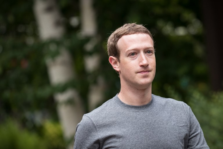 (FILES) This file photo taken on July 13, 2017 shows Mark Zuckerberg, chief executive officer and founder of Facebook Inc., attending the fourth day of the annual Allen & Company Sun Valley Conference  in Sun Valley, Idaho.  Facebook on October 2, 2017 said it will hire more than 1,000 people to thwart deceptive ads crafted to knock elections off course. The announcement came as the leading social network turned over to Congress some 3,000 Russia-linked ads that appeared to use hot-button issues to turn people against one another ahead of last year's US election.  / AFP PHOTO / GETTY IMAGES NORTH AMERICA / Drew Angerer