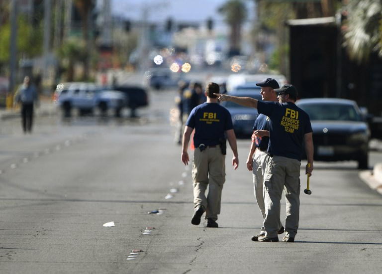 FBI investigators work outside the Route 91 festival venue after a gunman killed more than 50 people and wounded more than 200 others when he opened fire on a country music festival in Las Vegas, Nevada on October 3, 2017.   Police said the gunman, a 64-year-old local resident named as Stephen Paddock, had been killed after a SWAT team responded to reports of multiple gunfire from the 32nd floor of the Mandalay Bay, a hotel-casino next to the concert venue. / AFP PHOTO / Mark RALSTON