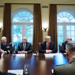 US President Donald Trump, flanked by Defense Secretary James Mattis (L), and Chief of Staff John Kelly (R), hold a meeting with senior military leaders in the Cabinet Room of the White House on October 5, 2017. / AFP PHOTO / Mandel NGAN