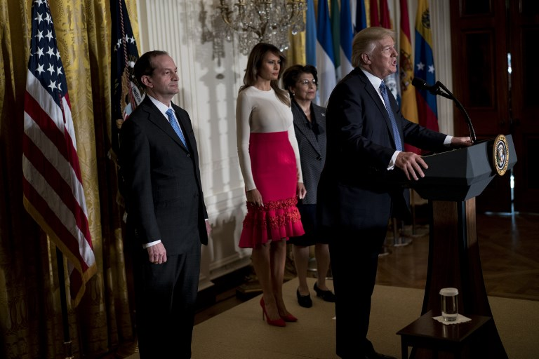 US Secretary of Labor R. Alexander Acosta (L), US First Lady Melania Trump (2L) and Jovita Carranza (2R), Treasurer of the United States, listen while US President Donald Trump speaks during a Hispanic Heritage Month event in the East Room of the White House October 6, 2017 in Washington, DC. President Trump invited over 200 Hispanic business, community, and faith leaders, and guests from across the country to join in the celebration of Hispanic Heritage Month. / AFP PHOTO / Brendan Smialowski