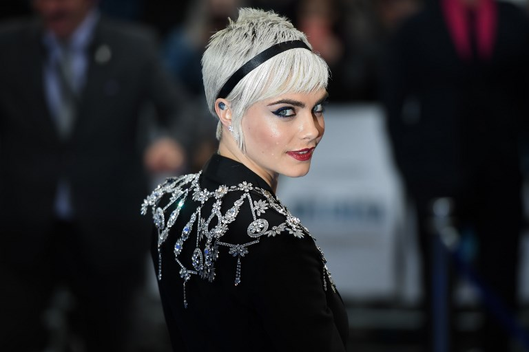"(FILES) This file photo taken on July 24, 2017 shows British model and actress Cara Delevingne posing for a photograph upon arrival for the European premiere of ""Valerian and The City of a Thousand Planets"" in London. Model and actress Cara Delevingne on October 11, 2017 accused disgraced Hollywood mogul Harvey Weinstein of propositioning her and attempting to kiss her after a meeting about an upcoming film. In a statement released via her publicist, the 25-year-old alleged she had initially received an ""uncomfortable call"" from the producer, during which he questioned her about her sexuality.  / AFP PHOTO / Chris J Ratcliffe"