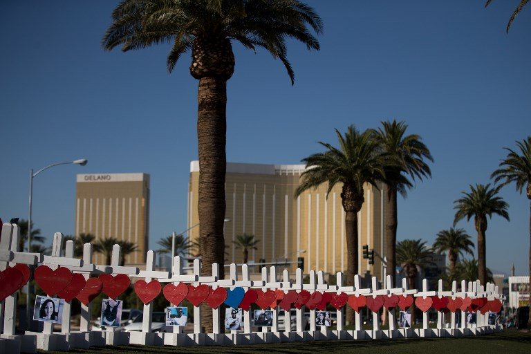 LAS VEGAS, NV - OCTOBER 5: With the Mandalay Bay Resort and Casino in the background (at right), 58 white crosses for the victims of Sunday night's mass shooting stand on the south end of the Las Vegas Strip, October 5, 2017 in Las Vegas, Nevada. On October 1, Stephen Paddock killed at least 58 people and injured more than 450 after he opened fire on a large crowd at the Route 91 Harvest country music festival. The massacre is one of the deadliest mass shooting events in U.S. history.   Drew Angerer/Getty Images/AFP