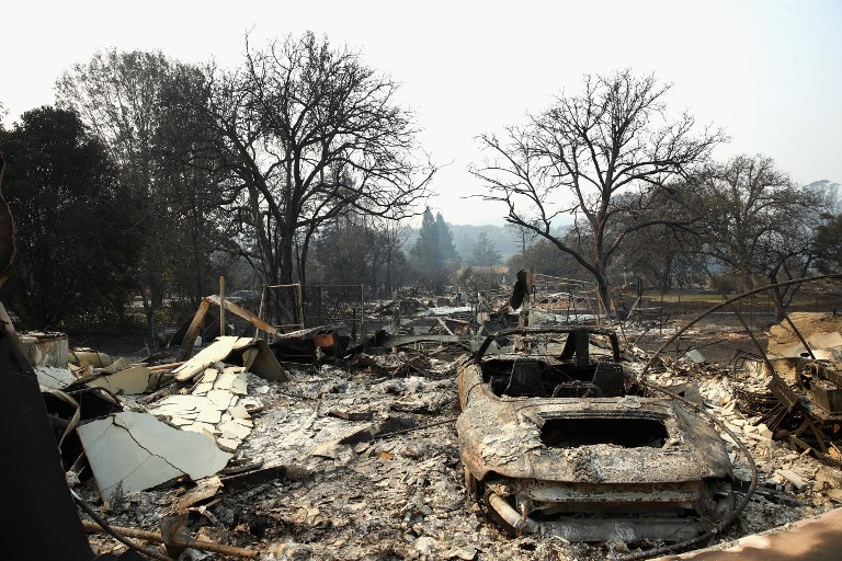 KENWOOD, CA - OCTOBER 11: Homes are left completely destroyed by the Tubbs Fire on October 11, 2017 in Kenwood, California. In one of the worst wildfires in state history, more than 2,000 homes have burned and at least 17 people have been killed as more than 14 wildfires continue to spread with little containment in eight Northern California counties.   Ezra Shaw/Getty Images/AFP