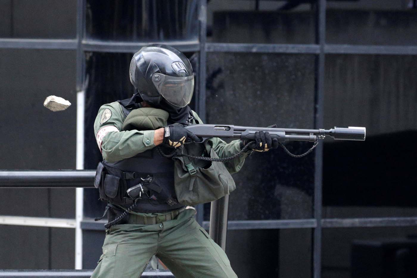 Riot police fire tear gas while clashing with opposition supporters rallying against President Nicolas Maduro in Caracas, Venezuela May 3, 2017. REUTERS/Marco Bello