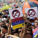 Opposition supporters take part in a rally against Venezuela's President Nicolas Maduro's government in Caracas
