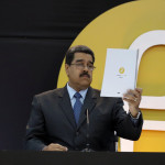 "Venezuela's President Nicolas Maduro reads a document during the event launching the new Venezuelan cryptocurrency ""Petro"" in Caracas"