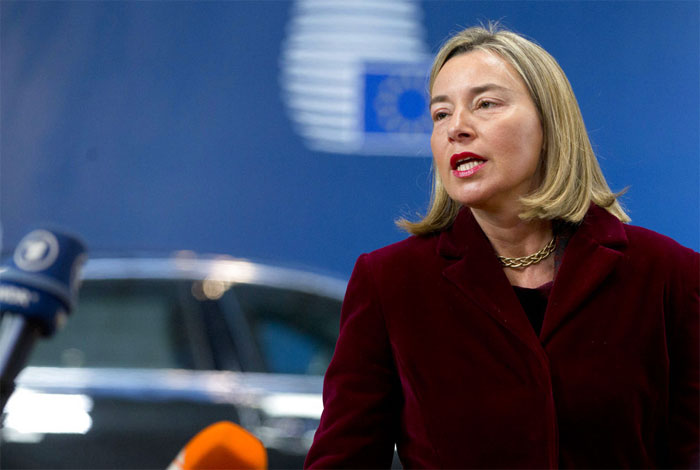 European Union foreign policy chief Federica Mogherini speaks with the media as she arrives for a meeting of EU foreign ministers at the Europa building in Brussels on Monday, Feb. 26, 2018.