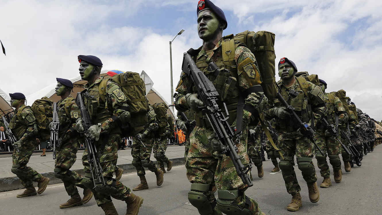 Special forces soldiers march during a military parade celebrating Colombia's 204 anniversary of independence from Spain in Bogota, Colombia, Sunday, July 20, 2014. (AP Photo/Fernando Vergara)