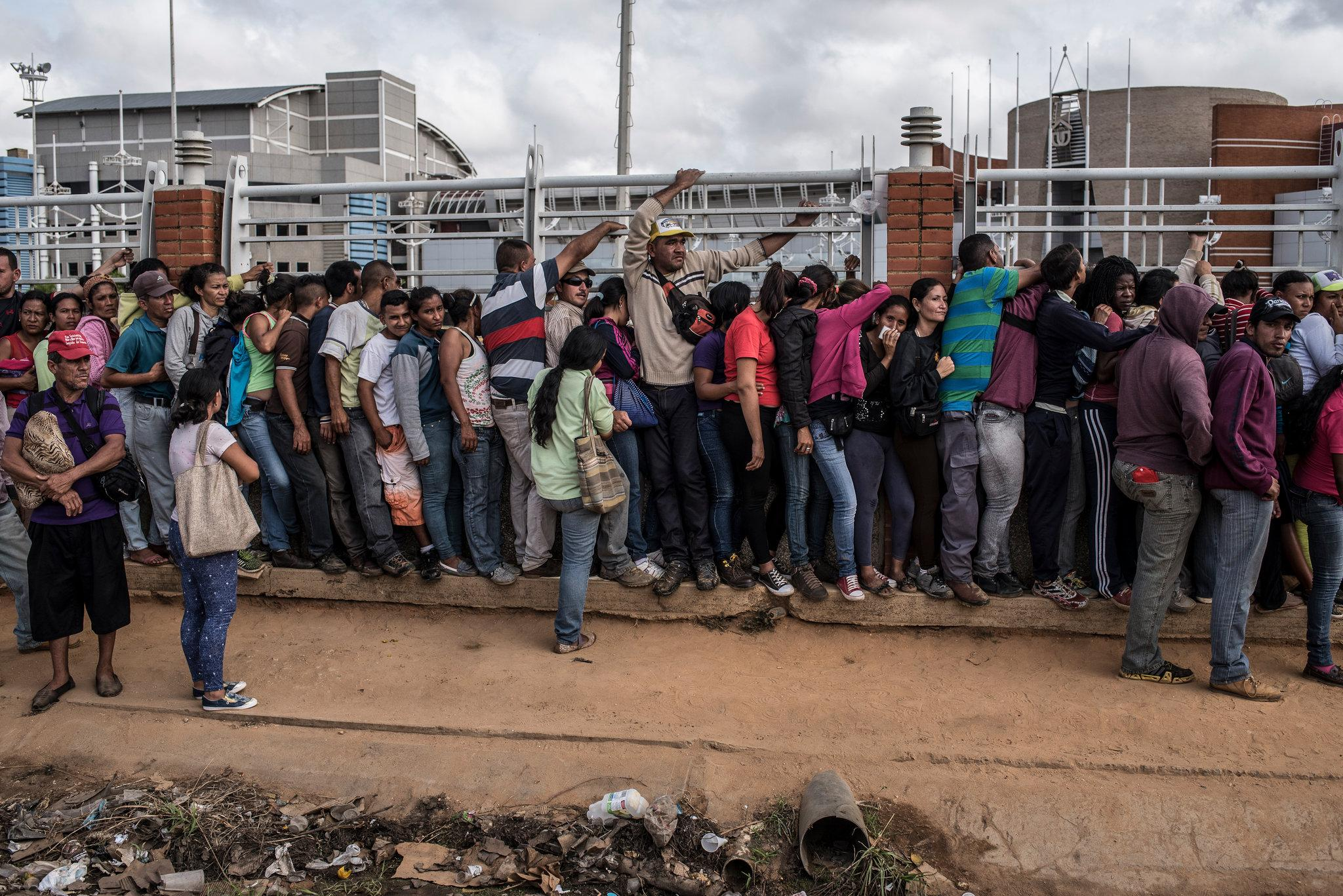 Venezuelans waited in line for a day last month outside a supermarket in El Tigre to buy corn meal.CreditThe New York Times
