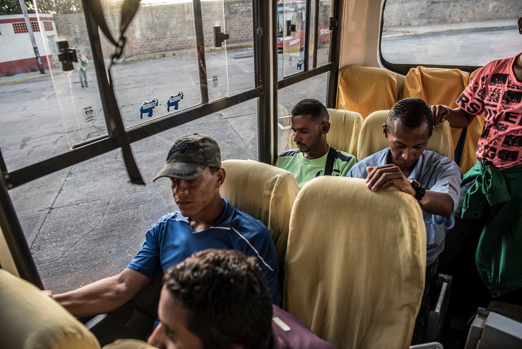 Carlos Nava, in green, worked on a drilling crew for Venezuela's state oil company near El Tigre, but he quit last year because he could not live on what had become starvation wages.CreditThe New York Times