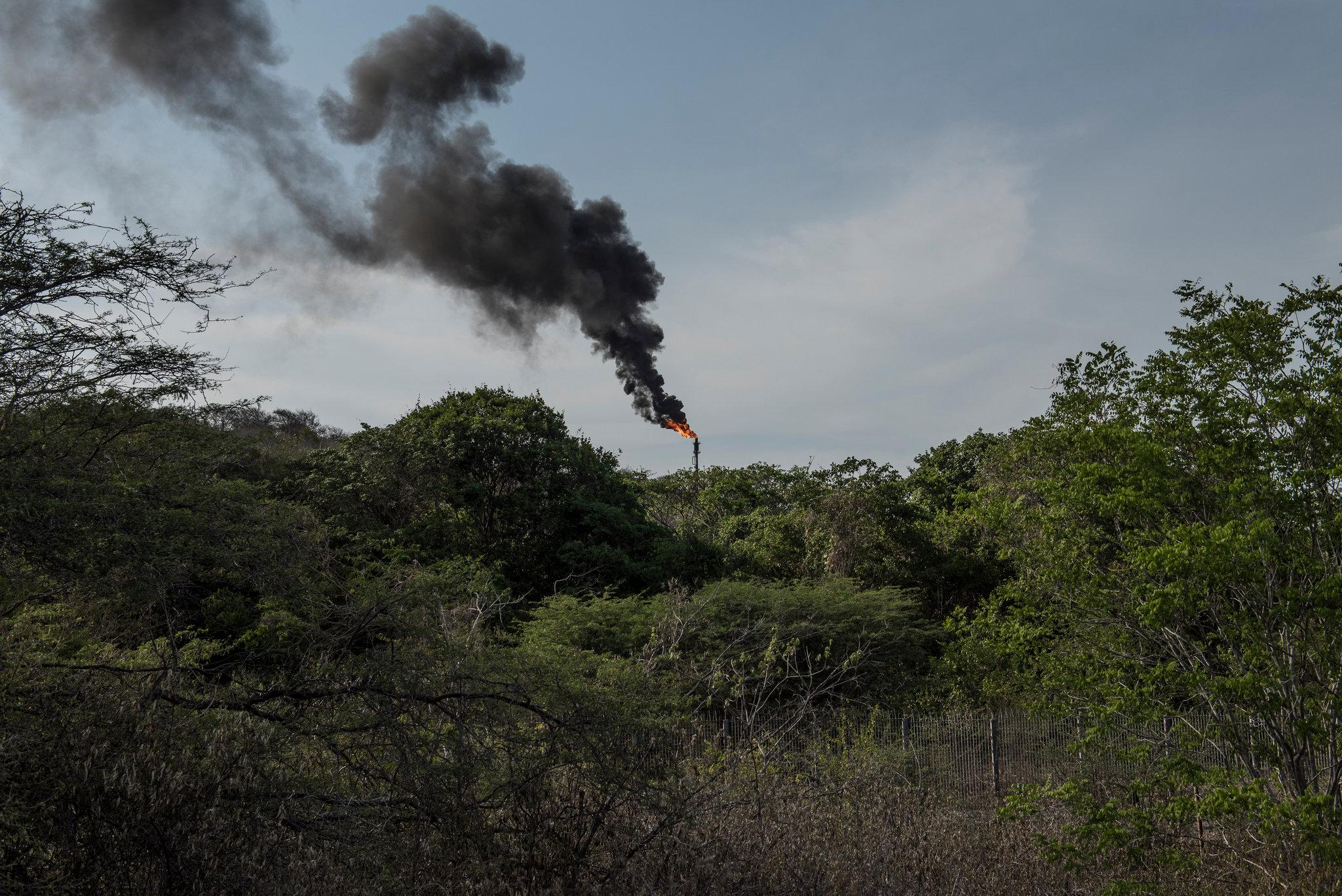 Excess gas being burned off at a division of the state oil company in Anzoátegui, in northeastern Venezuela.CreditThe New York Times