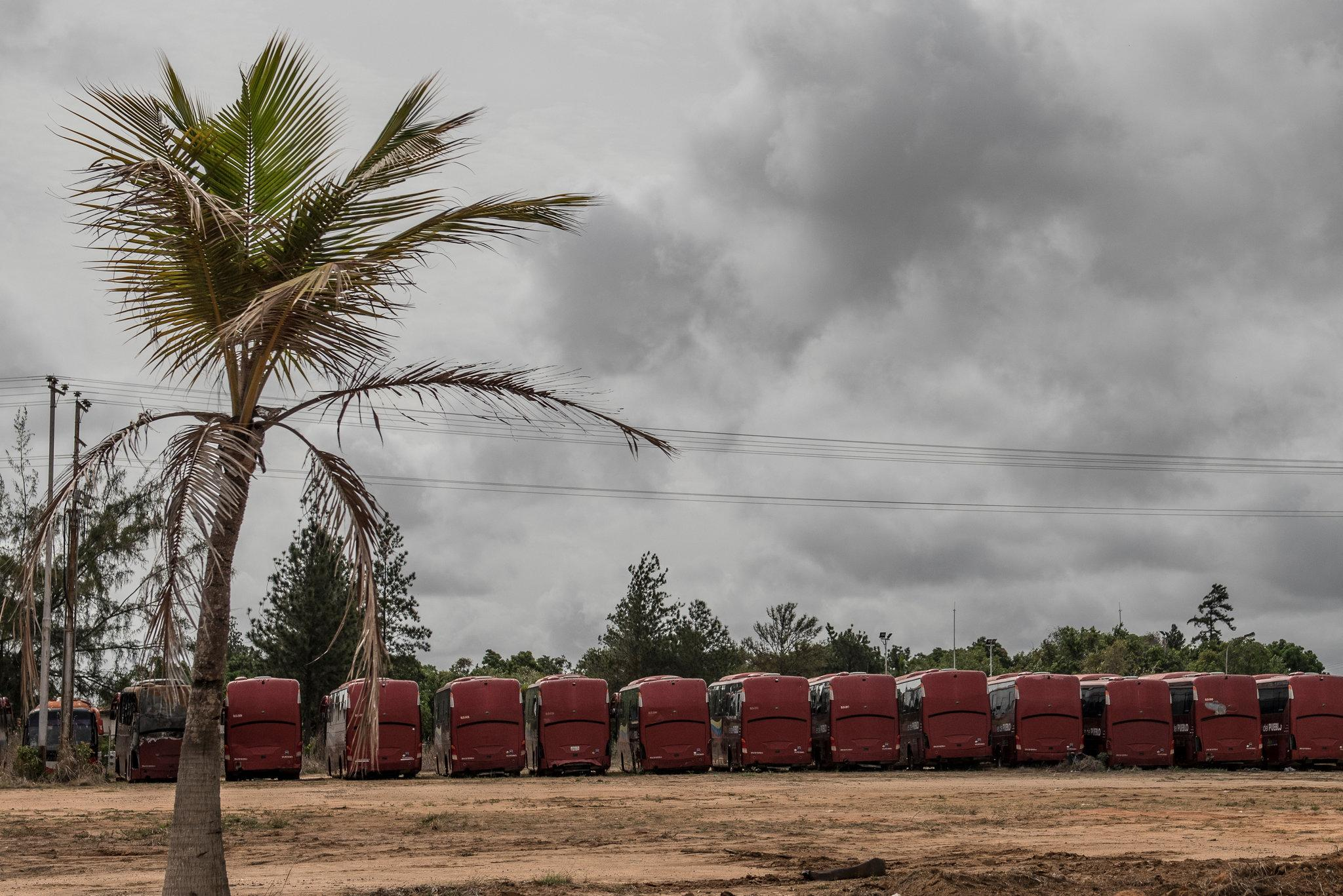 Buses once used by oil workers at a residential and commercial complex in San Tomé, Venezuela, have been abandoned because of a lack of spare parts.CreditThe New York Times