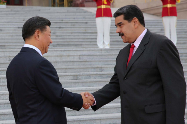 Chinese President Xi Jinping and Venezuela's President Nicolas Maduro shake hands during his welcoming ceremony in Beijing, China September 14, 2018. Miraflores Palace/Handout via REUTERS ATTENTION EDITORS - THIS PICTURE WAS PROVIDED BY A THIRD PARTY